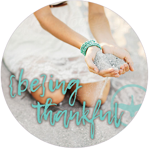"""woman with hands together, cupped, palms up, with text """"being thankful"""" in scripty font over top"""